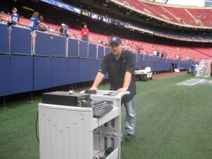 Philip Nelson rolls the TriCaster to it's next location.. The locker room.