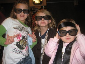 Kids love 3D! You can see the excitement on their faces before Hannah Montana in 3D. :)