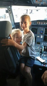 Tip #10 - Scarlet and Natalie get a photo in the captain's seat on a recent American Airlines Flight!